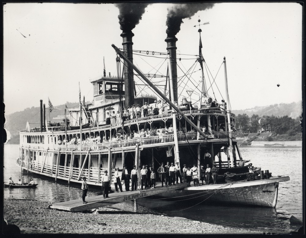"Steam packet ""Joe Fowler"" on the shore of the Ohio River with passengers posing for their portrait."