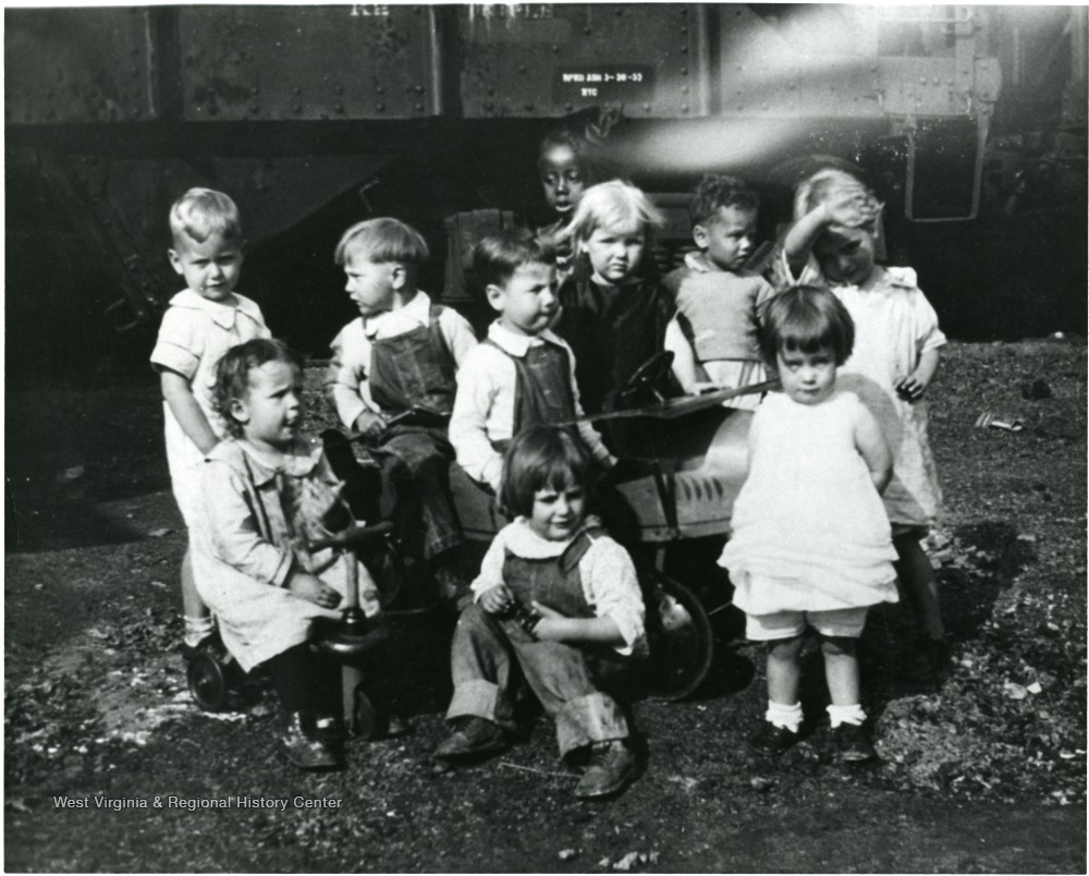 The picture presents a group of children in the first Nutrition Nursery School in Monongalia County, W. Va. directed by Dr. Stalnaker's class in Child Psychology.