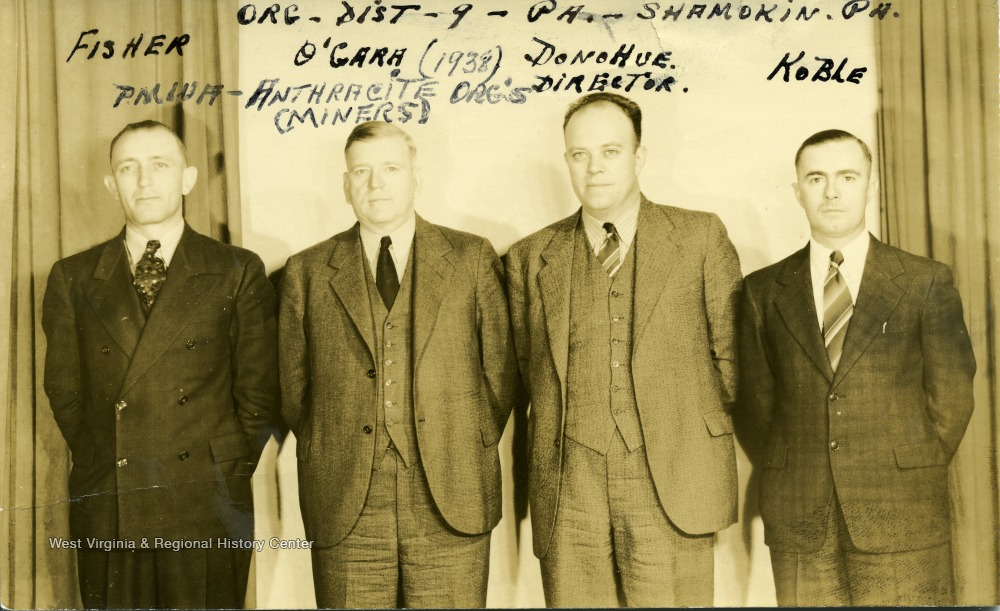Group portrait of anthracite organizers of the P.M.W.A.  'Org- Dist - 9 - Pa. - Shamokin, Pa.'  From left to right, Fisher, O'Gara, Director Donohue, Koble.