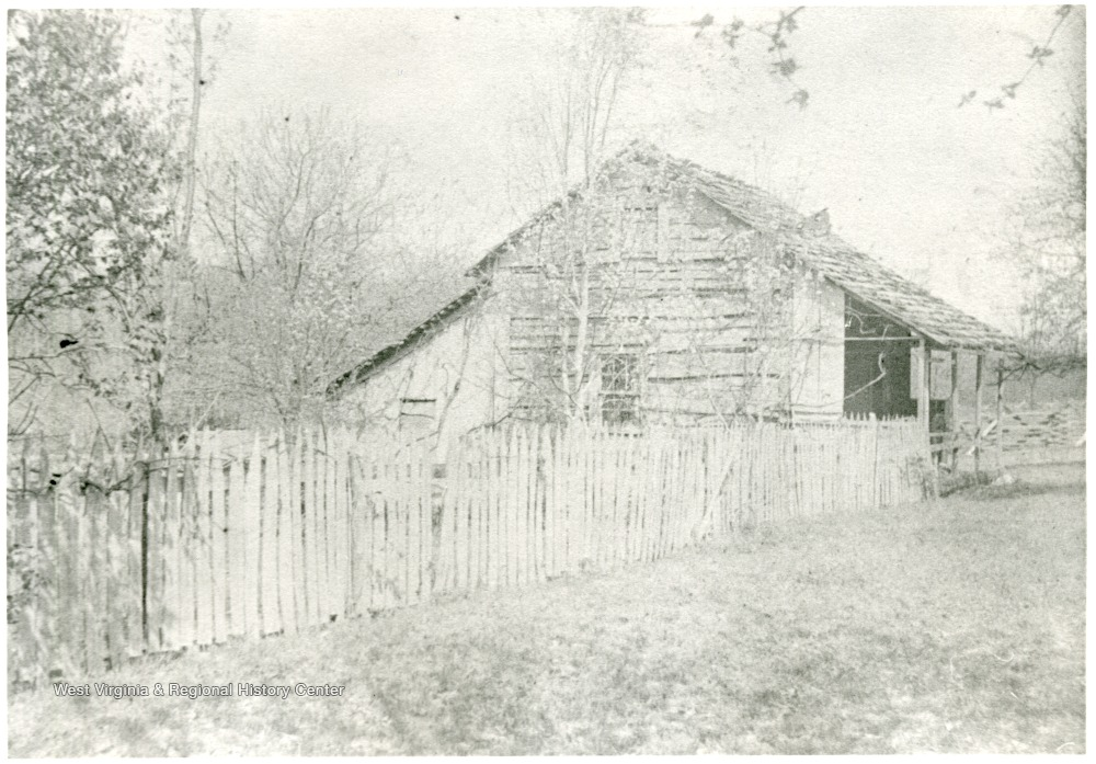 Gottfried Aegerter's first home in Helvetia, W. Va.  House surrounded by a picket fence.