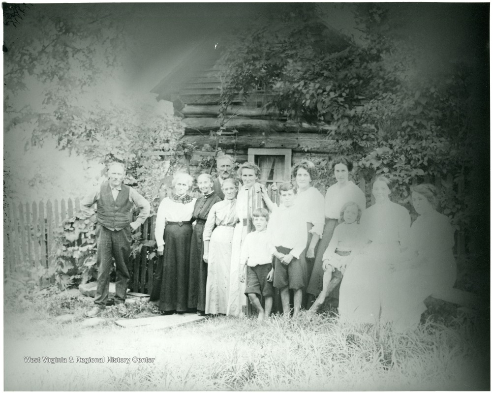 Group in front of Gottfried and Mary Burky's cabin on Turkeybone Mountain near Helvetia, W. Va.