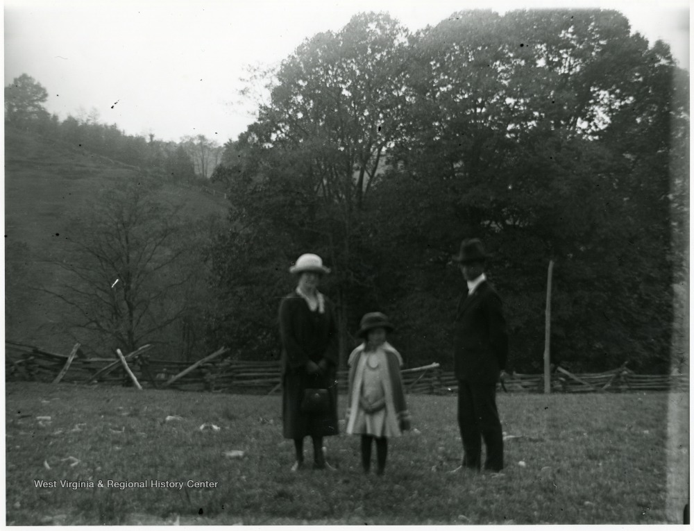 Olga Aegerter Holtkamp, Benjamin Holtkamp, and young girl standing in fenced in field area, Helvetia, W. Va.