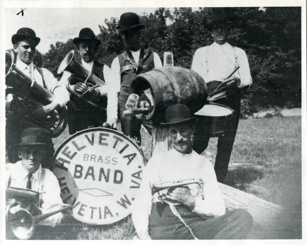 Six members of the Helvetia Brass Band with their instruments.