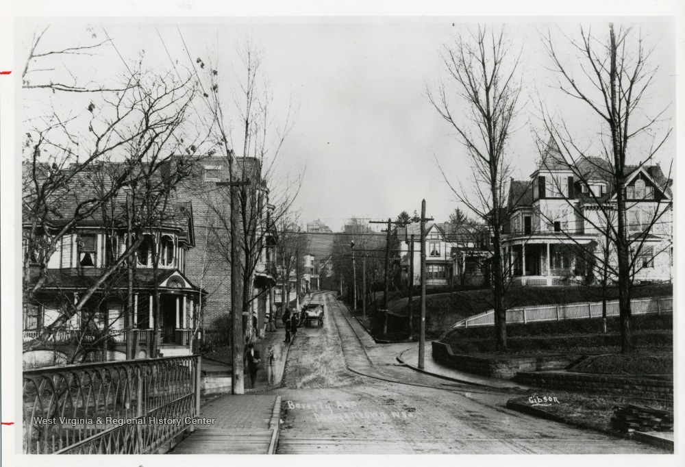 Inscribed on the photograph; 'A view down Beverly Avenue (now the intersection of University and Stewart), taken around 1910, shows a quiet sunnyside of one family dwellings. Beverly Avenue is now University Avenue at Stewart Street.'