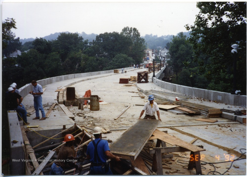 A nearly finished South Park bridge. Workers can be seen in progress.