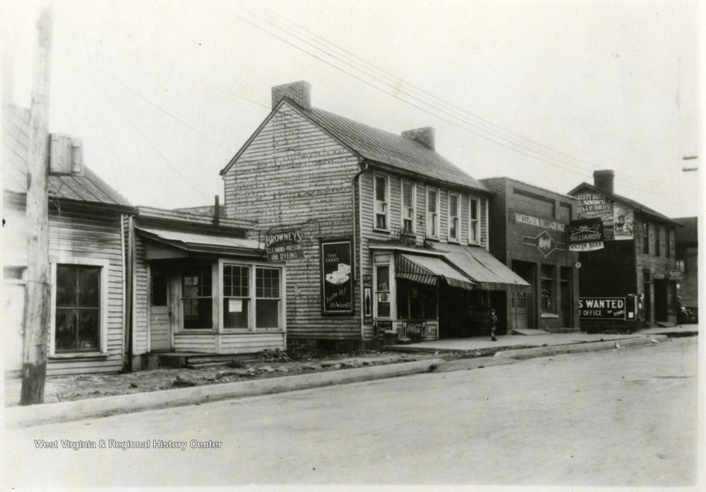 'Looking N. W. on University Ave. to corner of Same and Moore St.  Showing frontage of Lepera Property.'