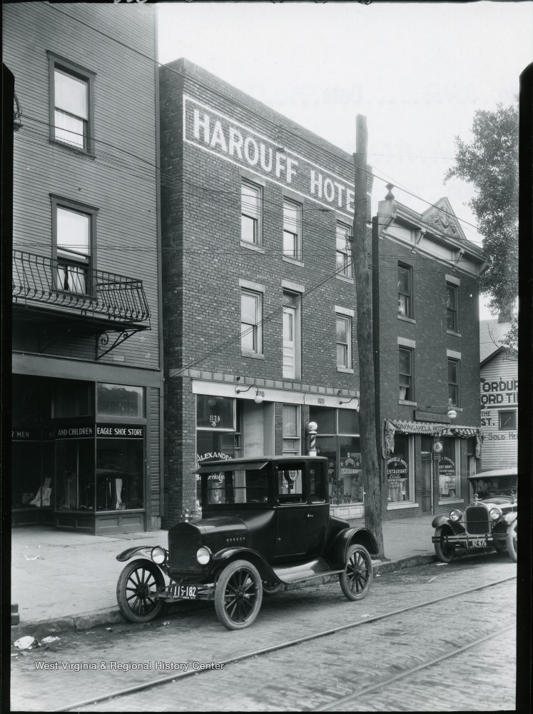 A view on University Avenue showing Harouff and Monongahela Hotels.