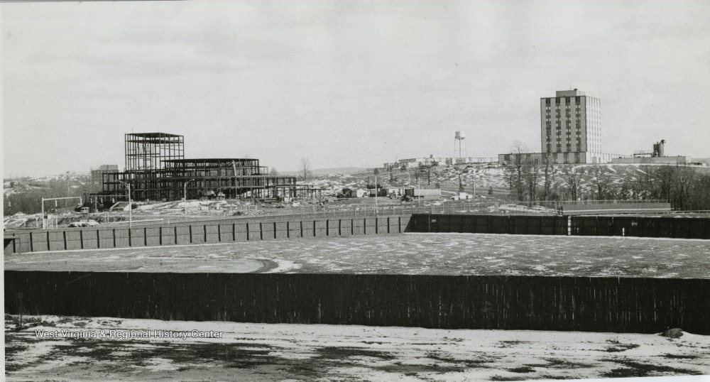 View of old Hawley Field, Creative Arts Center being constructed and Engineering building on hill.