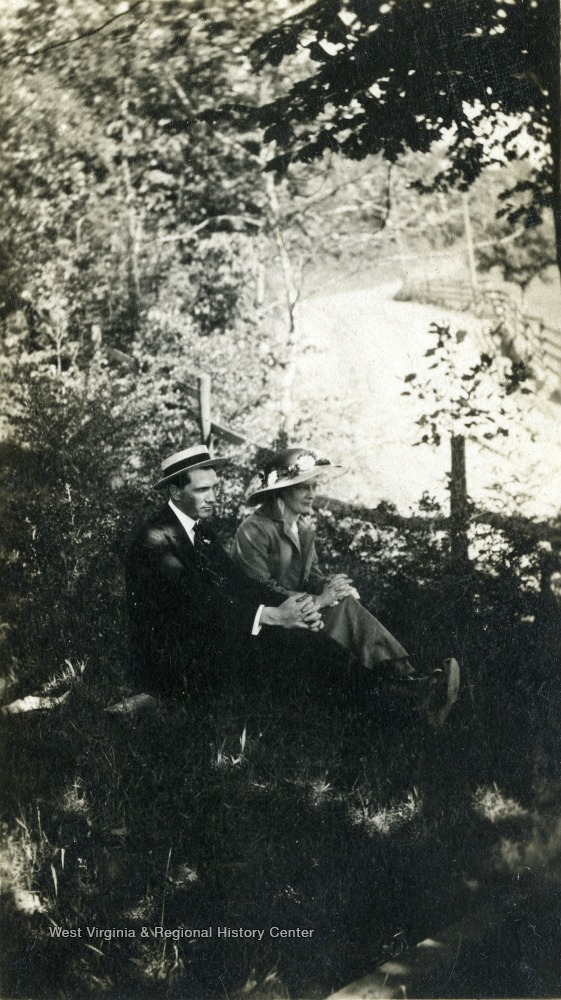Dadisman and a woman seated on a hillside.