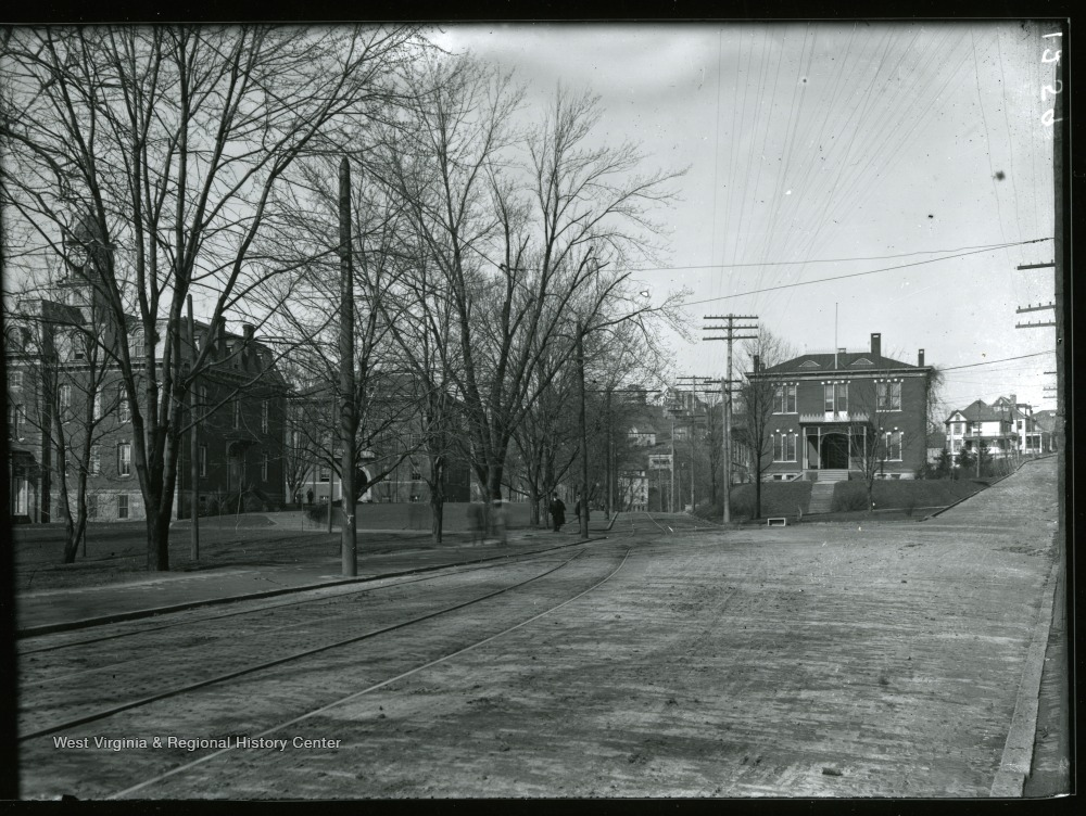 From left, Martin Hall, Science Hall (Chitwood Hall) and Agricultural Experiment Station; this picture is taken from the present site of Grumbein's Island. Note the trolley tracks in the foreground.