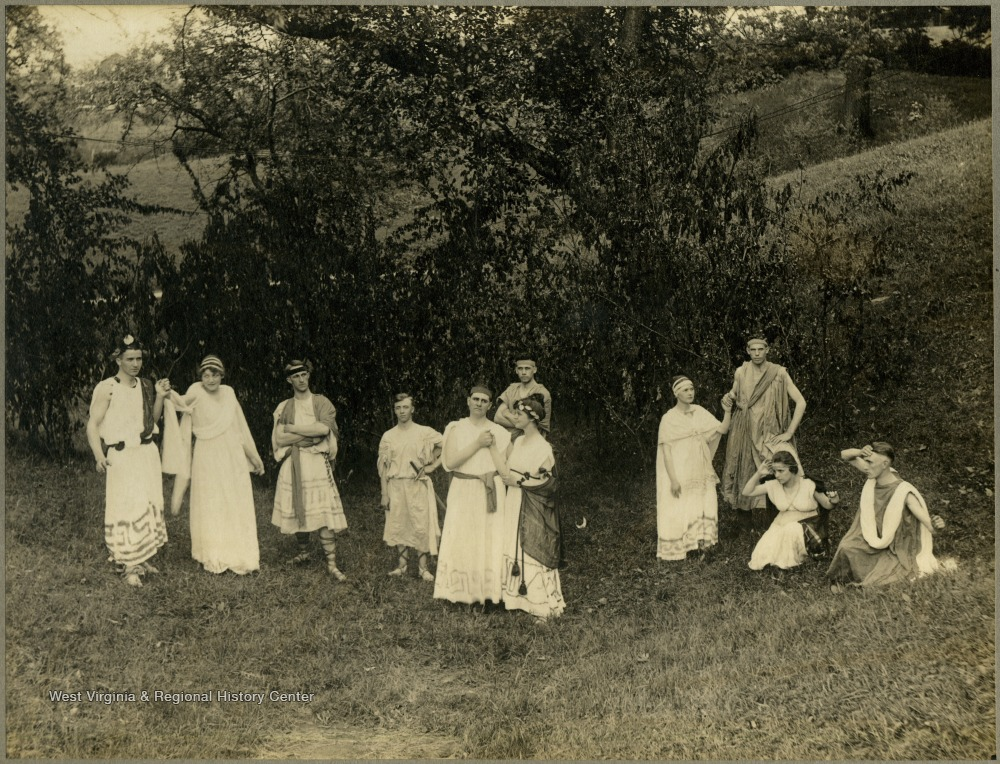 Student performers in togas and classical costumes. Taken on school property. Herscel D. Wade is the third person from the right.