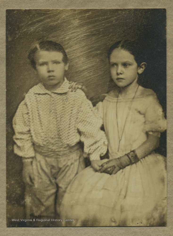 Portrait of two young members of the Davis family. It may be John W. Davis' mother on the right.