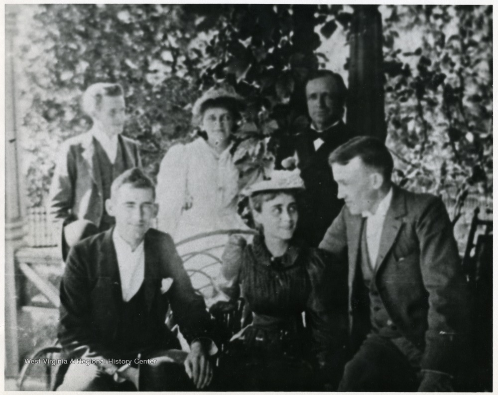"'Back row: Jim Ewing, Louise Moderwell, and Gov. A. B. Fleming; Front Row: Brad Clarkson, Gypsy Fleming, Fay Hartley (married Louis Moderwell); Oh, Gypsy! ""Or light or dark, or short or tall, She sets a springe to snare them all; All's one to her - above her fan, She'd make sweet eyes at Caliban.""'"