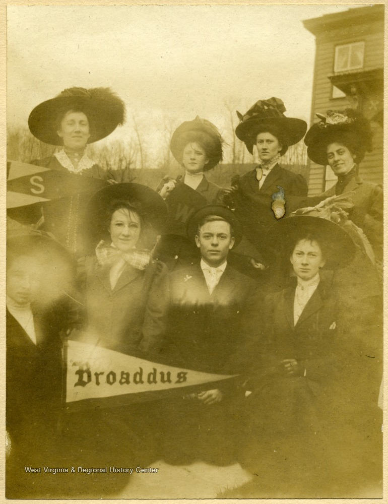 'Taken at Hardway Home, Lost Creek, W. Va. Front row- far right, Gertrude Hardway(a student). Back row(1st and 3rd) from left, Calora Hardway and Margaret Hardway, sisters. Probably others are Broaddus Students.