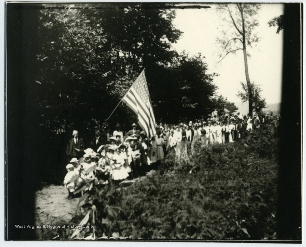 A parade at Helvetia, probably the 4th of July.