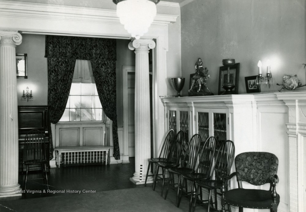 "Interior of the house, west end of north wall of room to right of ""?"". Also known as Shepard Hall, the structure was built in 1798 by Moses Shepard."