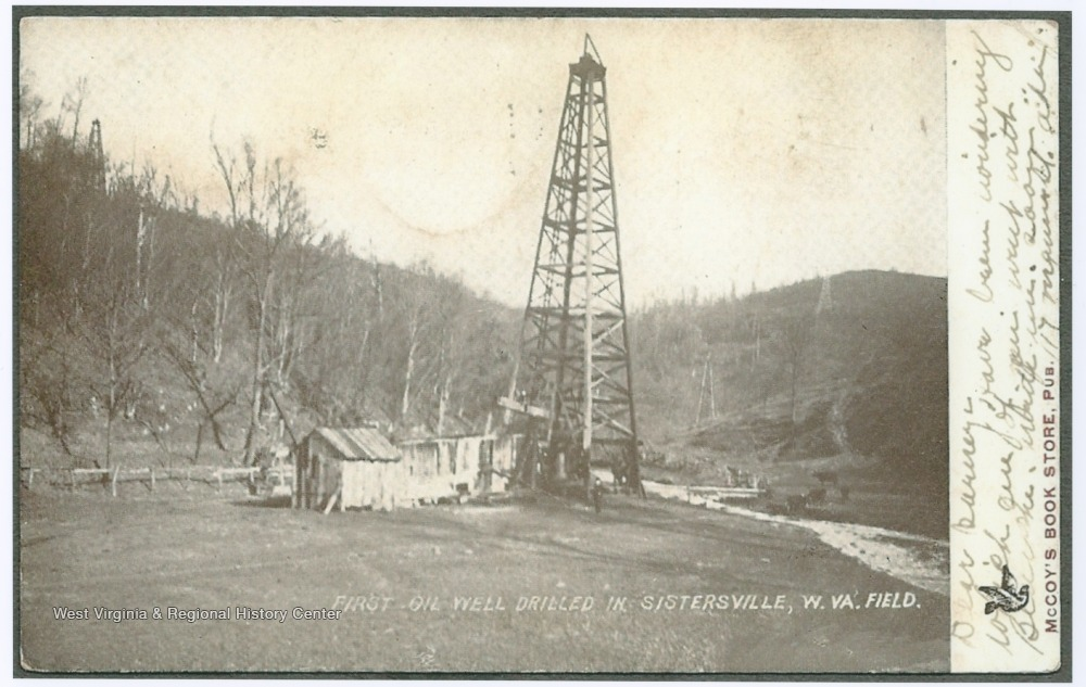 Postcard photograph of a derrick capping the first drilled well in Sistersville field.