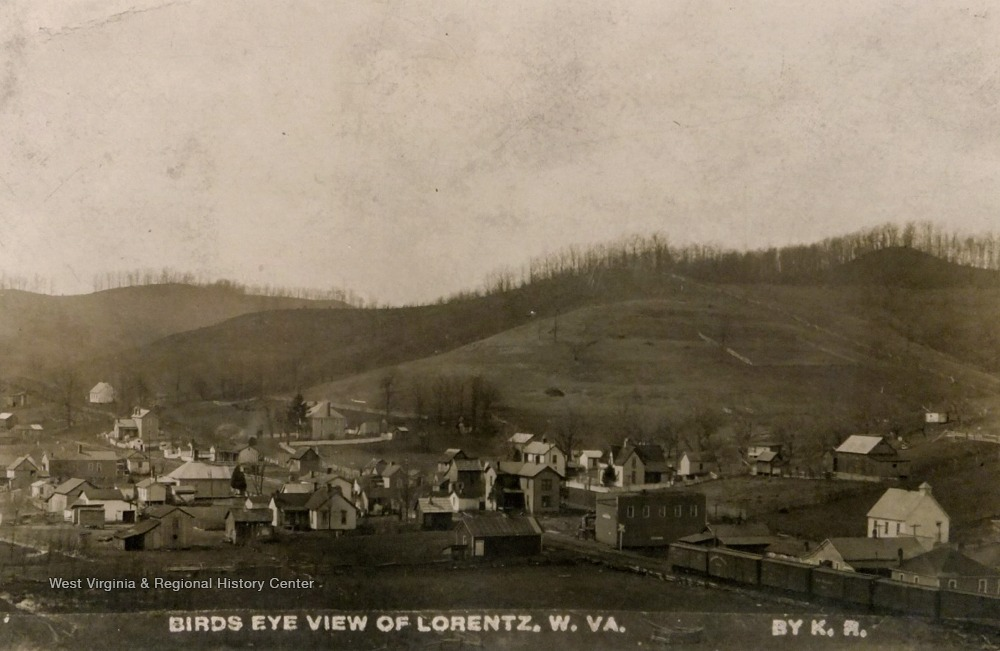 Homes in the town of Lorentz, West Virginia. Train going through town in bottom right corner.