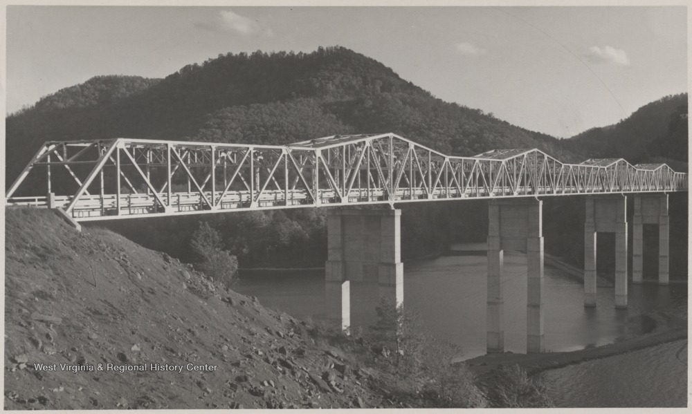 "The bridge was formerly known as ""Bluestone High Bridge"" before its name was changed to what it is today. The structure stands tall over the river."