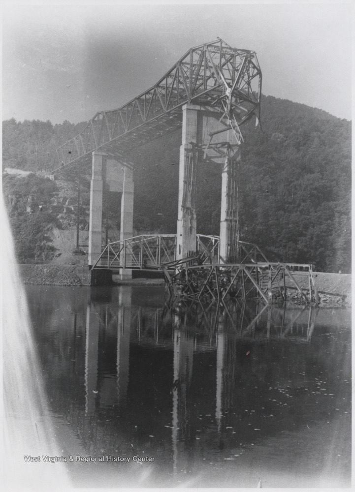 Part of the bridge fell during its construction in 1948. Steel pieces sit in the mouth of the Bluestone River.
