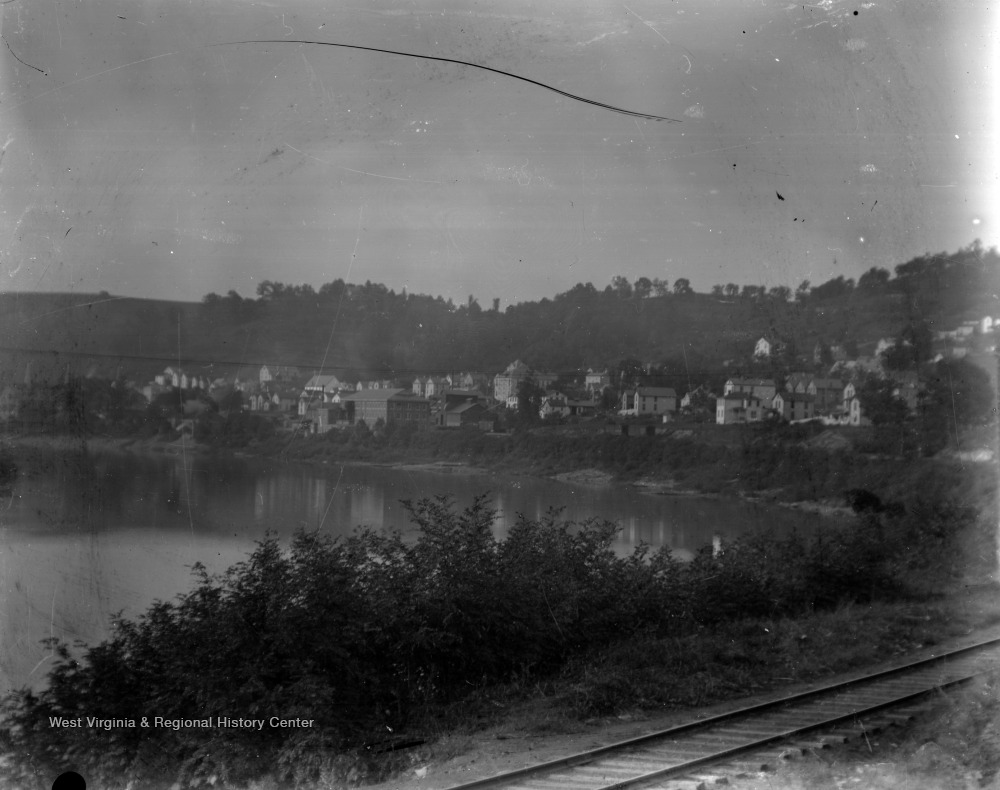 View from the sharp bend in the river, along the railroad tracks, looking back on Seneca before the glass works were moved there