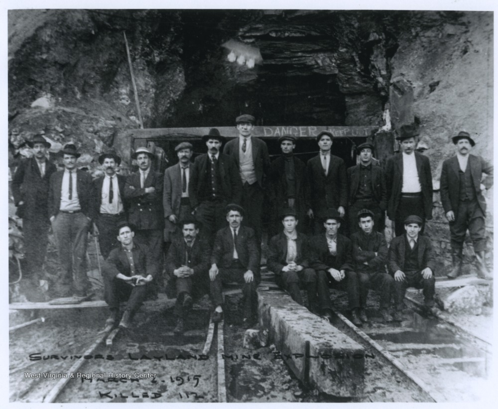 The nineteen survivors of the Layland mine explosion are pictured together outside of the mine entrance. The accident left 112 miners dead. The mine was operated by the New River and Pocahontas Consolidated Coal Company.