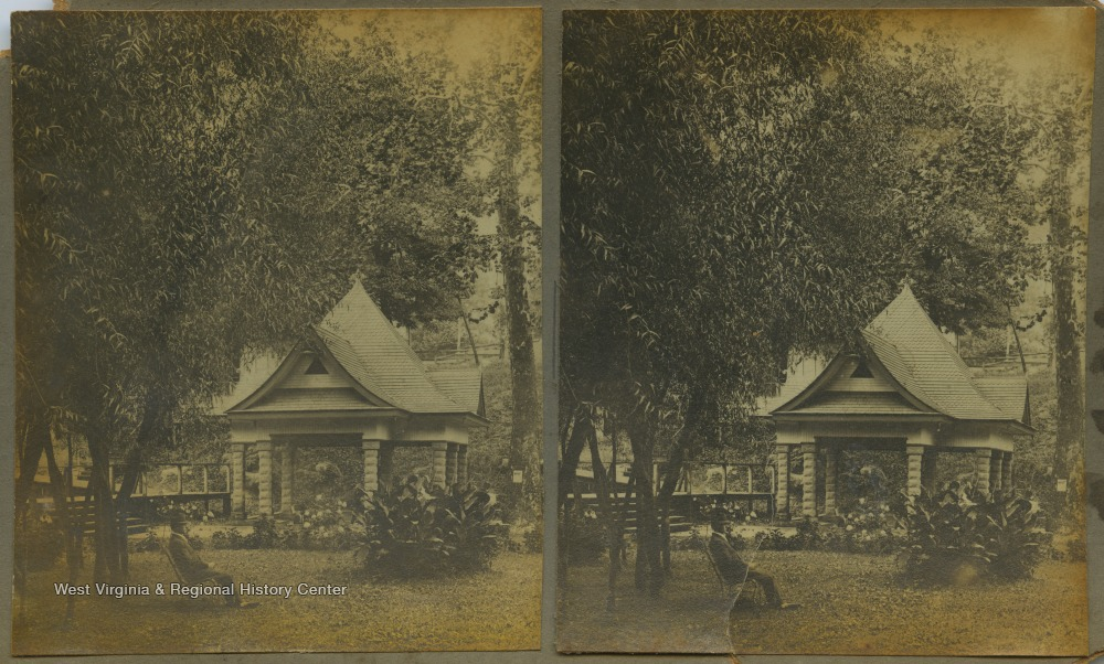 "A man sits on a chair in the lawn. In the background is a small pavilion. The stereograph is part of photographer William Dunnington's ""Webster Springs Series."""