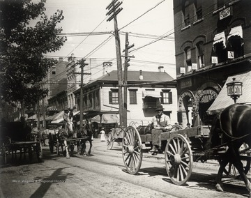 Horses, wagons, and pedestrians on High Streeet.<br />