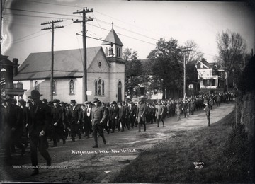Armistice Day Parade on University Avenue, Morgantown; Purinton House is visible in the background.<br />