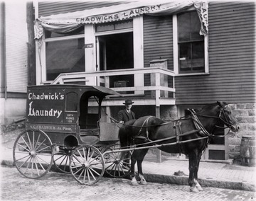 Chadwick's laundry wagon on Chestnut Street, Morgantown; the wagon is parked in front of the building for Chadwick's Laundry.