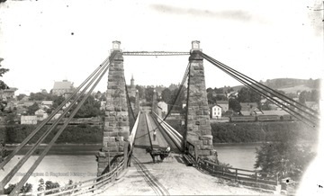Suspension bridge across the Monongahela River; the viewpoint is from Westover looking toward Morgantown.<br />
