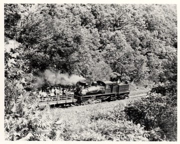 Shay No. 4 pushing passenger cart up a hill. Cass Scenic R.R.; Cass, W.V.