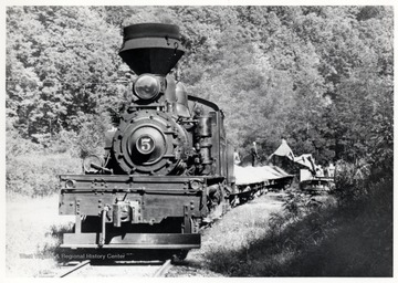 Shay No. 5 being loaded by a tractor. Cass Scenic R.R.; Cass, WV; John P. Killoran, Promotion Officer,WV State Parks,<br />Chas, WV 25305