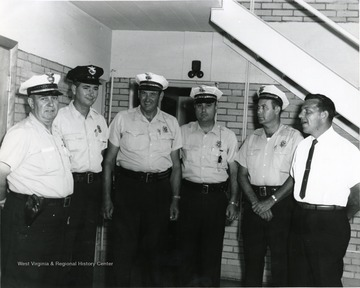 From left to right: 'Police Chief John Lewis, William Musgrave, Bill Hughes, Bennie Palmer, George Katchur, Robert West'.
