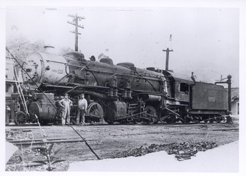 This was the first Mallet locomotive to come up the C and O Greenbrier Division; Notice the carbon arc light with globe suspended above pole behind engine cab. This picture was taken several years after the first run was made in 1905.