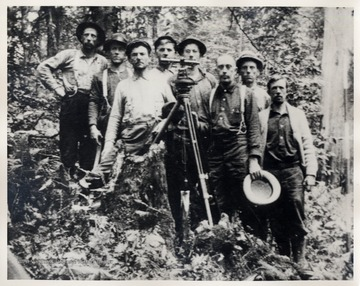 Portrait of crew with surveying equipment.