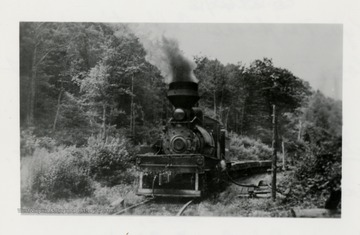 Shay No. 4 engine traveling on tracks.