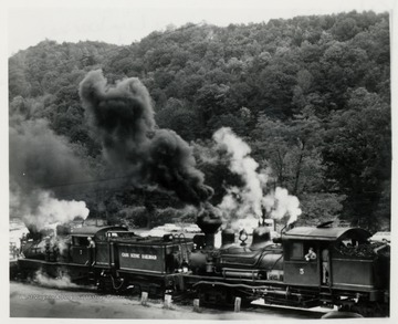 Cass Scenic Railroad.  Two train engines at station.  Original from Earl Palmer.