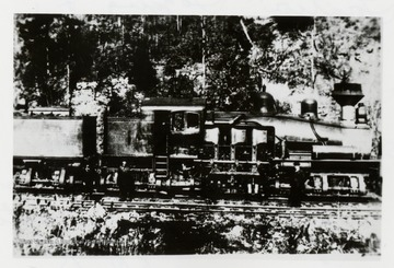 Side view of Shay train engine.