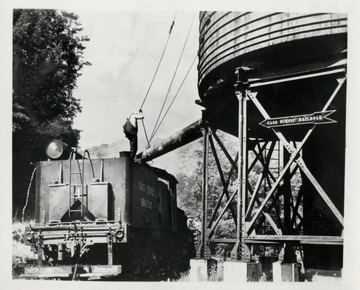 No. 4 takes on a tank of water, and it takes 1,500 gallons of it from nearby Leatherback Creek for each puffing trip up Cheat Mountain, with about 400 thrilled passengers, that is.  The neighboring Chesapeake and Ohio Railway donated the water tank.