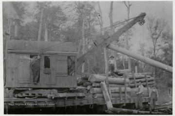 "Log loader with crew. ""This is the way they load logs on the Elk River.  S.G."""