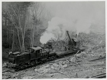 Shay No. 4 train engine pushing/pulling a lumber loading cart.