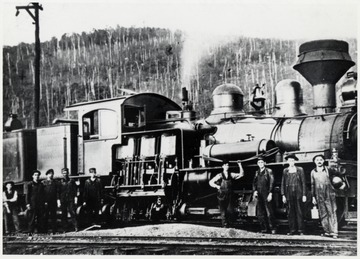 Shay train engine No. 10 and its crew.  (Lima 1914) at Cass.  Spruce, WV. Crew  Ed Lyle - fireman on far right.  Note Lantern on Locomotive.