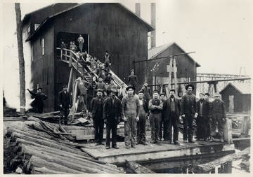 Mill crew at Glen Ray, W.Va. (Near Aldersonn).  Man in left background, John Rossi.