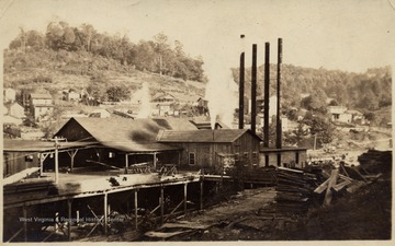 Ranwood Lumber Company Mill.  Four smoke stacks visible.