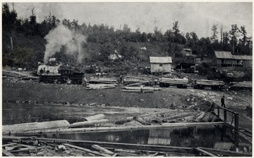 The Jacob L. Rumbarger Lumber Company's Shay locomotive, No. 1 and crew unloading logs.