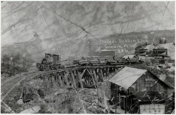 Train pulling lumber carts in Dobbin, W.Va.