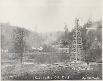 Oil Derricks McCabe, Rolan, Gilbert, Roland, and Douglass No. 2 amongst homes at Cornwallis.