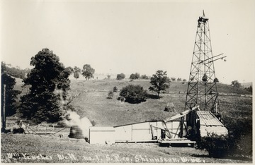 Oil rig and derrick in the countryside.