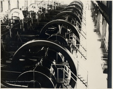 Line of horizontal engines with big fly wheels.